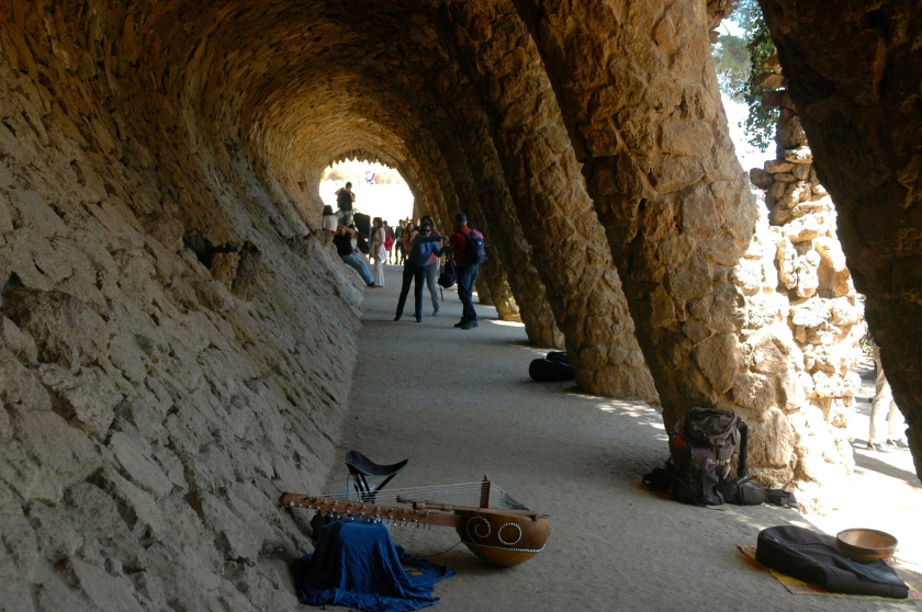 Things to do in Barcelona Spain Park Guell Full Time Explorer Tunnel Rock Arch Archway Music